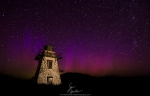 The St. Peter's Lighthouse on the North Shore of Prince Edward Island stands against a backdrop of purple Northern Lights.  The lighthouse was light-painted with a spotlight camera-right.  10 mm, ISO 1600, f/4, 30 sec.